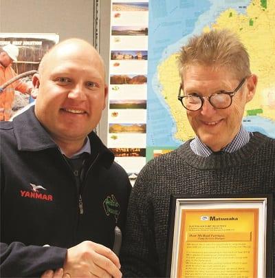 Warwick Lorenz (left), Australian Pumps Managing Director, awards Bradley Farrugia the 20 year Order of Merit certificate.