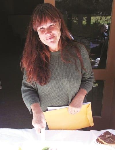 Theresa Neely cutting cake