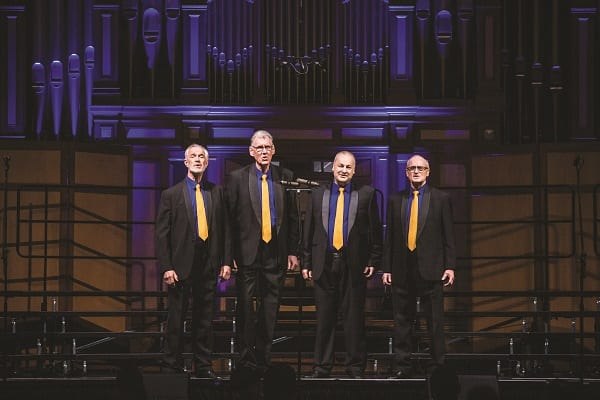HighJacked Harmony Quartet performing on stage during the competition in the magnificent Adelaide Town Hall