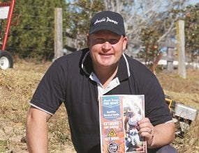 Aussie Pumps' Brad Farrugia with the famous Fire Chief and the comprehensive Bushfire Survival Guide.