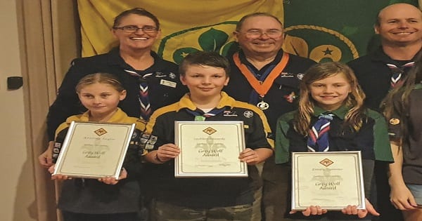 (Front) Kristina Taylor, Lachlan Edwards and Emily Symons(rear) Cub Scout Leader Mariell Taylor, Honorary Commissioner Garrett and Group Leader Simon Edwards