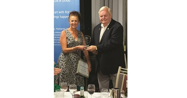 Donna receiving her award from Dural Rotary Club President, George Truelove